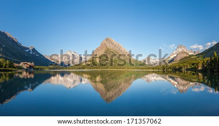 Mt Wilbur and reflection at Swiftcurrent lake in Glacier national park, Montana - stock photo