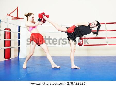 muai thai women fighting at training boxing ring - stock photo