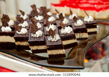 Much Chocolate dessert with cream - catering - stock photo