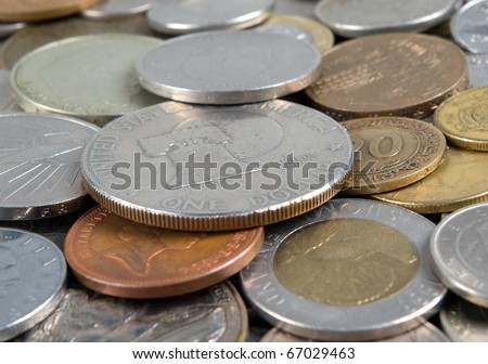 Much coins of the different countries. Dollar over all - stock photo