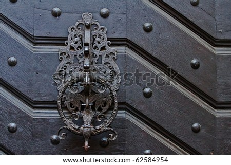 Much of the old dark door fittings - stock photo