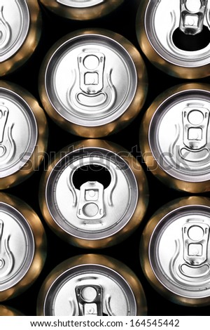 Much of yellow drinking cans close up - stock photo