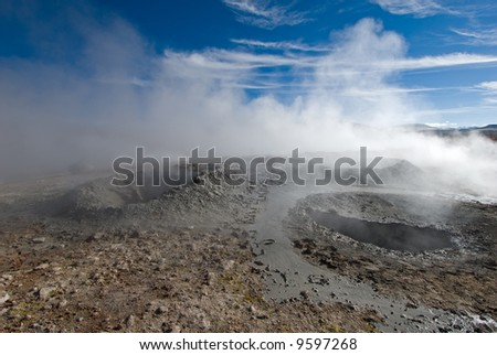 mud geyser over blue sky, altiplano, bolivia - stock photo
