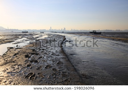 mud road of footprint in wetland low tidal wave, the oyster field scenes from hong kong to shenzhen coast at Ha Pak Nai, Yuen Long - stock photo
