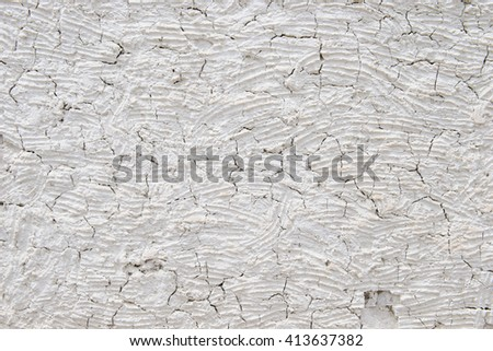 Mud wall with large gaping cracks - stock photo