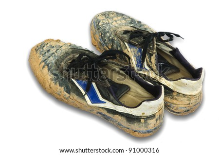 muddy old sneakers isolated on white background. - stock photo