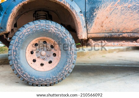 Muddy wheel - stock photo