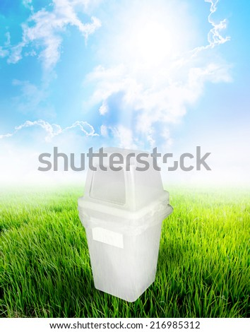 Muddy White Garbage Bin Ecology Concept With Landscape Background. - stock photo