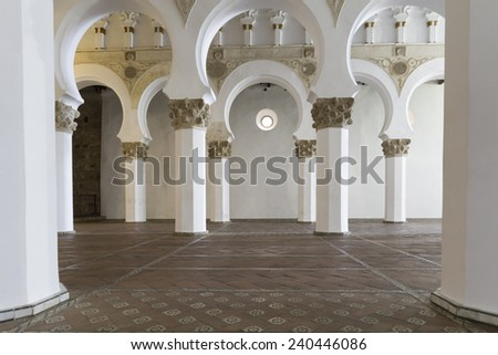 Mudejar arches inside the Santa Maria la Blanca synagogue in Toledo, Spain