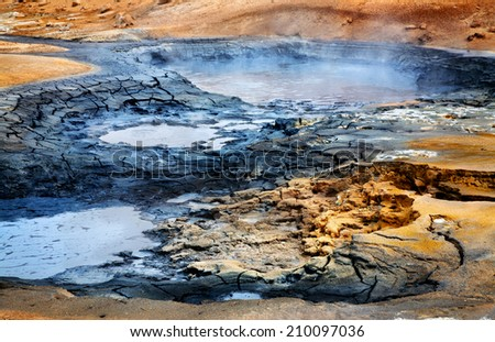 Mudpots at the geothermal area Hverir, Iceland. - stock photo