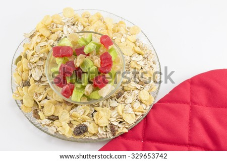 Muesli and dried fruit arranged in glass bowls - stock photo