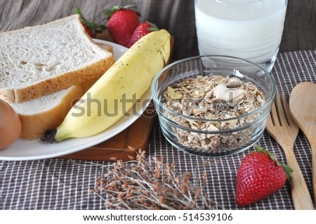 Muesli and fresh fruits with bread and milk for breakfast