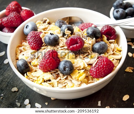 Muesli Bowl for Breakfast with Blueberries and Raspberries - stock photo