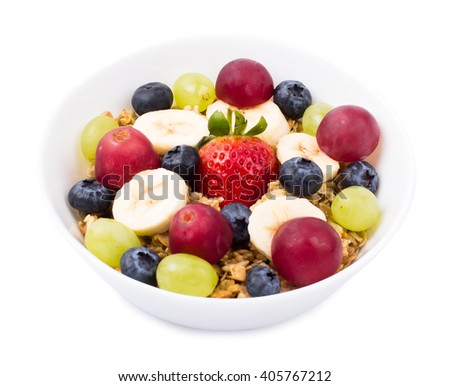 Muesli, fruit, berries in a bowl on a white background - stock photo