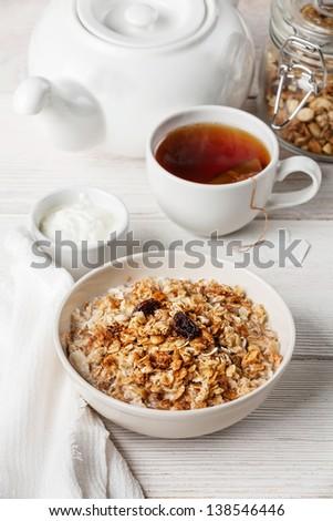 Muesli granola with raisin and yogourt in white bowl - stock photo