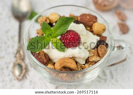 Muesli. Home made granola. A healthy Breakfast of cereals, fruit, berries, nuts and honey. Shallow depth of field  - stock photo