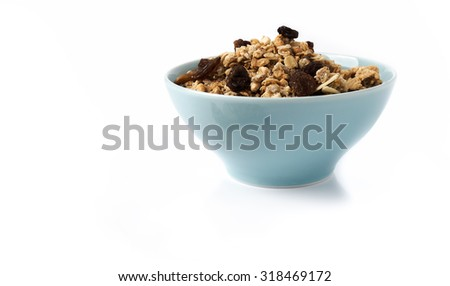 Muesli in bowl  on white background .