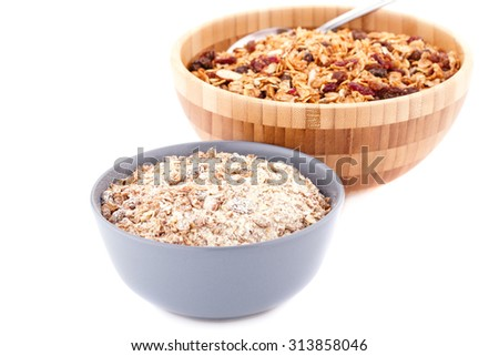 Muesli in the bowls isolated on white background. - stock photo