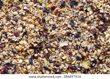 Muesli Oats Raisin Cereals Fruits Nuts Flakes Background Food Texture - stock photo