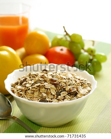 muesli of oats with raisin, fresh fruit and glass of juice