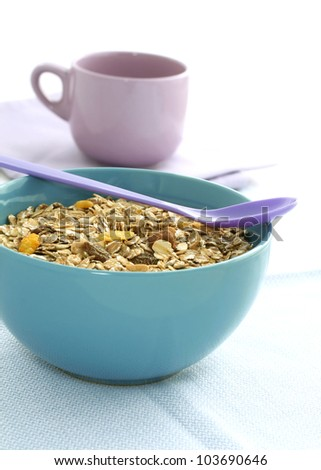 muesli of oats with raisin in bowl and cup