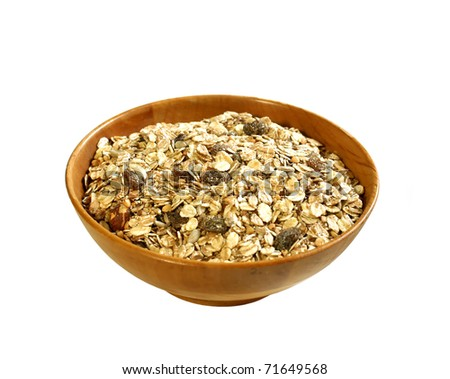 muesli of oats with raisin in wooden bowl isolated on white background - stock photo