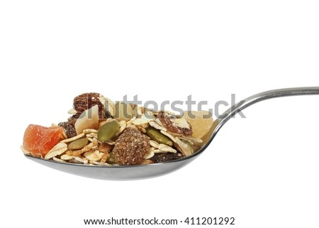 Muesli on spoon isolated on white background - stock photo
