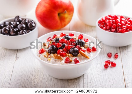 Muesli with fresh fruit - a good start to the day - stock photo