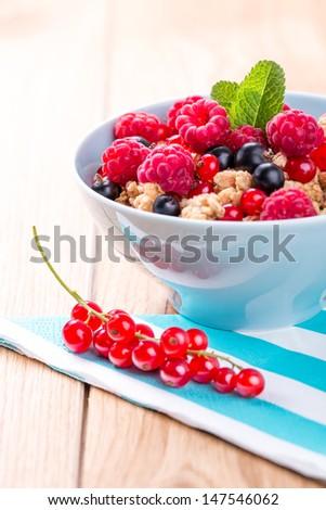 Muesli with fresh fruits. - stock photo