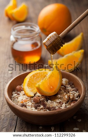 muesli with oranges and honey - stock photo