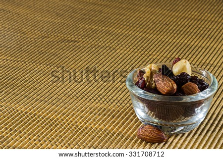 Muesli with raisin, currant, mix nut, coconut in a glass - stock photo