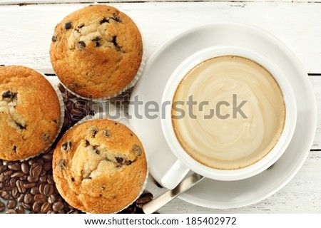 muffin and cup of coffee  - stock photo