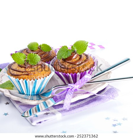 Muffin cakes with chocolate - stock photo