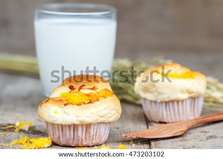 Muffin golden threads with wood fork and milk on wood table. Thai dessert call Foi Thong.