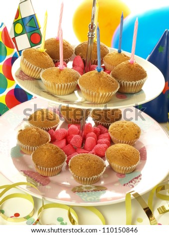 Muffins and jelly beans on the colorful background - stock photo
