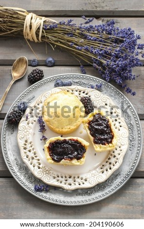 Muffins filled with blueberry and blackberry jam - stock photo