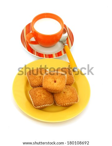 muffins on plate and a the cup of milk isolated on white background  - stock photo