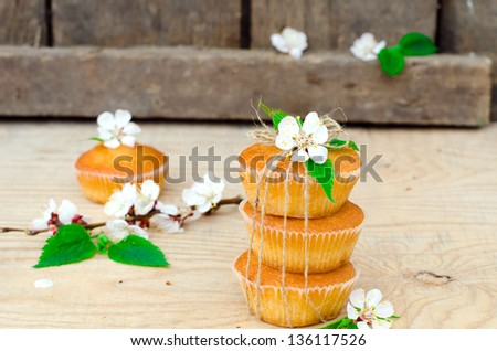 Muffins with filling on the wooden table, selective focus - stock photo