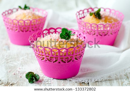 Muffins with powdered sugar and mint, Selective focus - stock photo