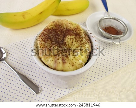 Mug cake from the microwave with banana and cocoa  - stock photo