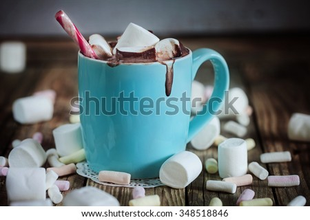 Mug filled with hot chocolate and marshmallow  and candy - stock photo