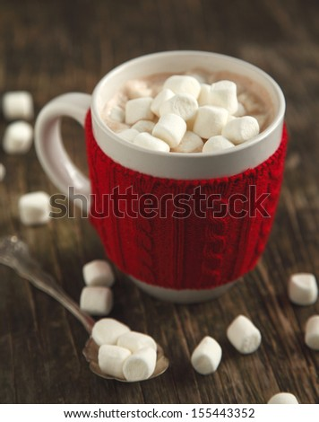 Mug filled with hot chocolate and marshmallows - stock photo