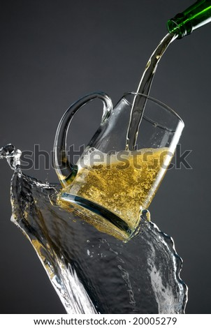 Mug of beer holds on water steram. Very high resolution. - stock photo