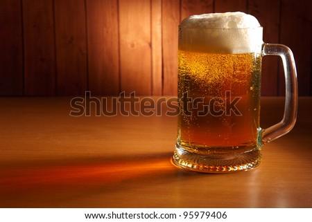 mug of beer on a pub table - stock photo