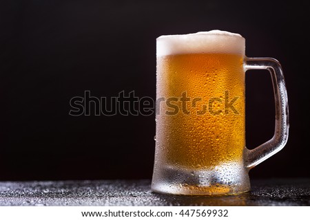 mug of beer on dark background - stock photo