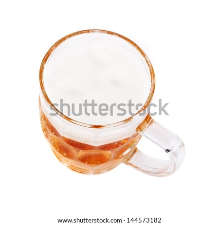 Mug of beer. Top view. Close-up. White background.