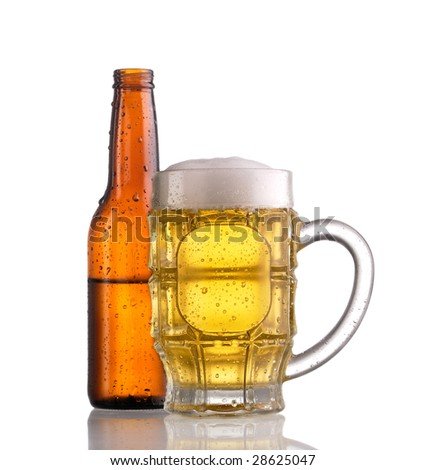 Mug of beer with froth in front of an open half filled brown bottle of beer, both showing condensation and droplets - stock photo