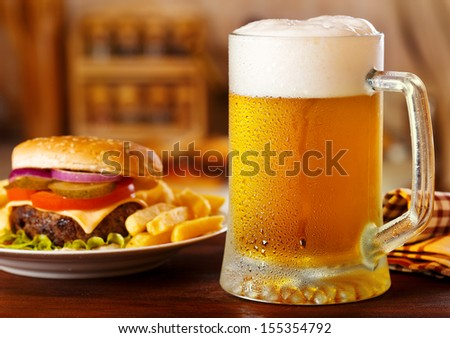 mug of beer with hamburger - stock photo
