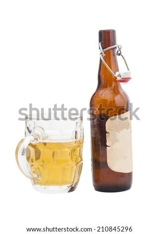 Mug of beer with  open half filled brown bottle of beer - stock photo