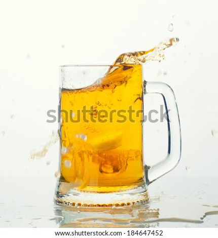 Mug of beer with splash and foam